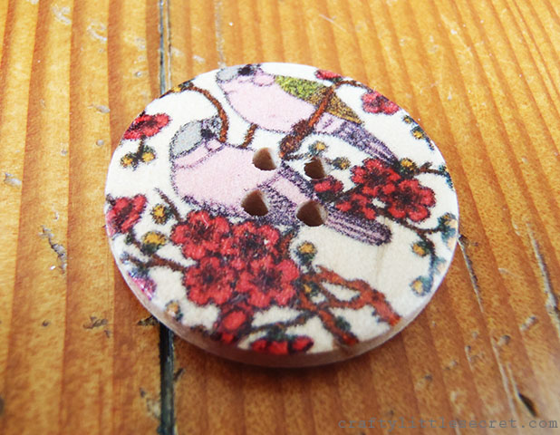 Painted wooden button